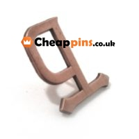 Pin of a letter in bronze finish.