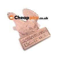 Custom lapel pins with chicken logo in bronze finish.