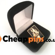 Velvet boxes for lapel pins.